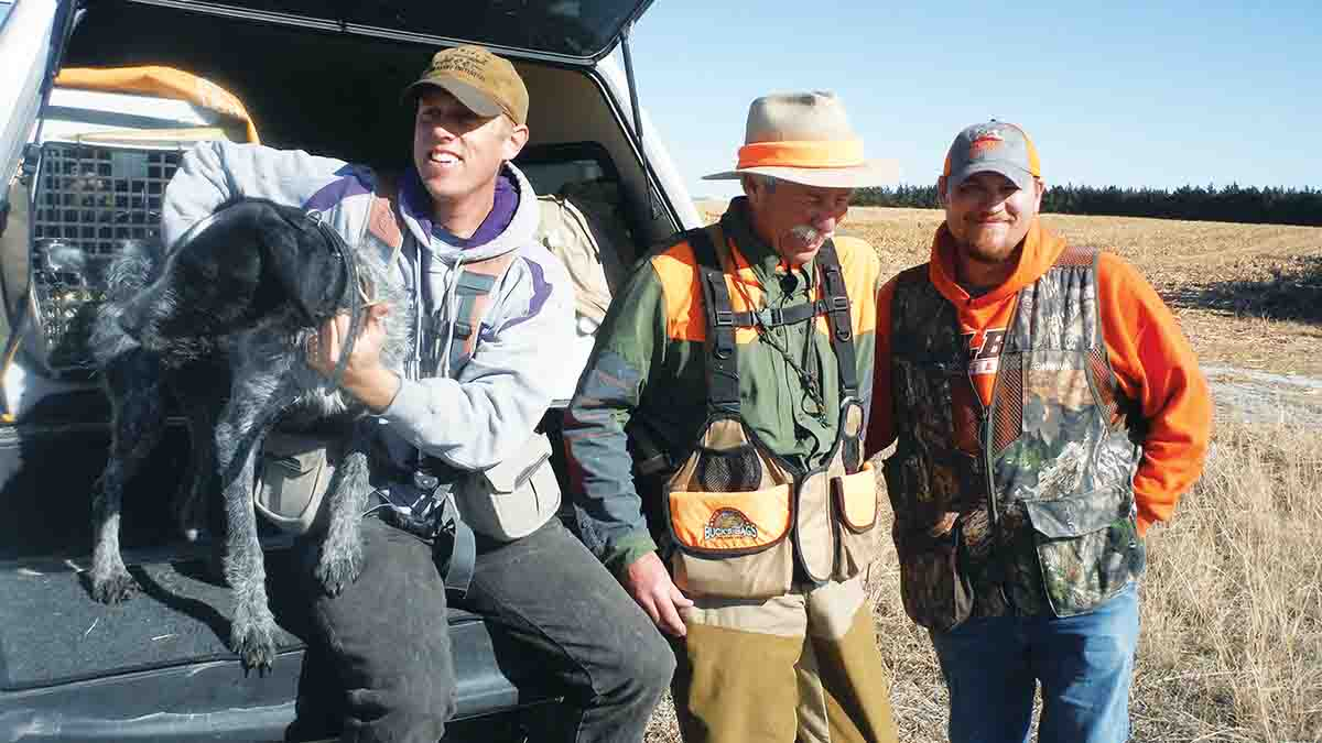 A Kansas walk-in hunt with Eric Wiens of the Kansas Department of Wildlife, Parks & Tourism (left); Scott Linden of Wingshooting USA TV (center); and Wes Sowards of the Kansas Department of Wildlife, Parks & Tourism (right).