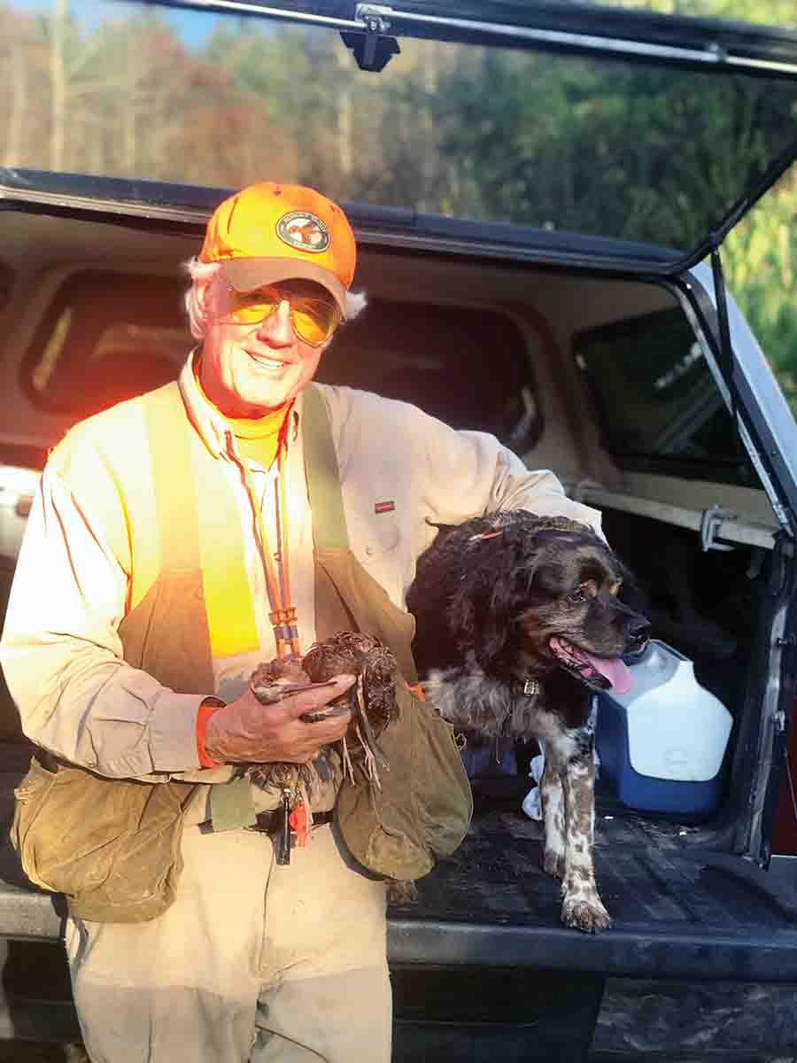 Host Jerry Bottcher poses with a brace of woodcock and his best pal Parker the French Brittany. (Photo/Matt DeLorenzo)