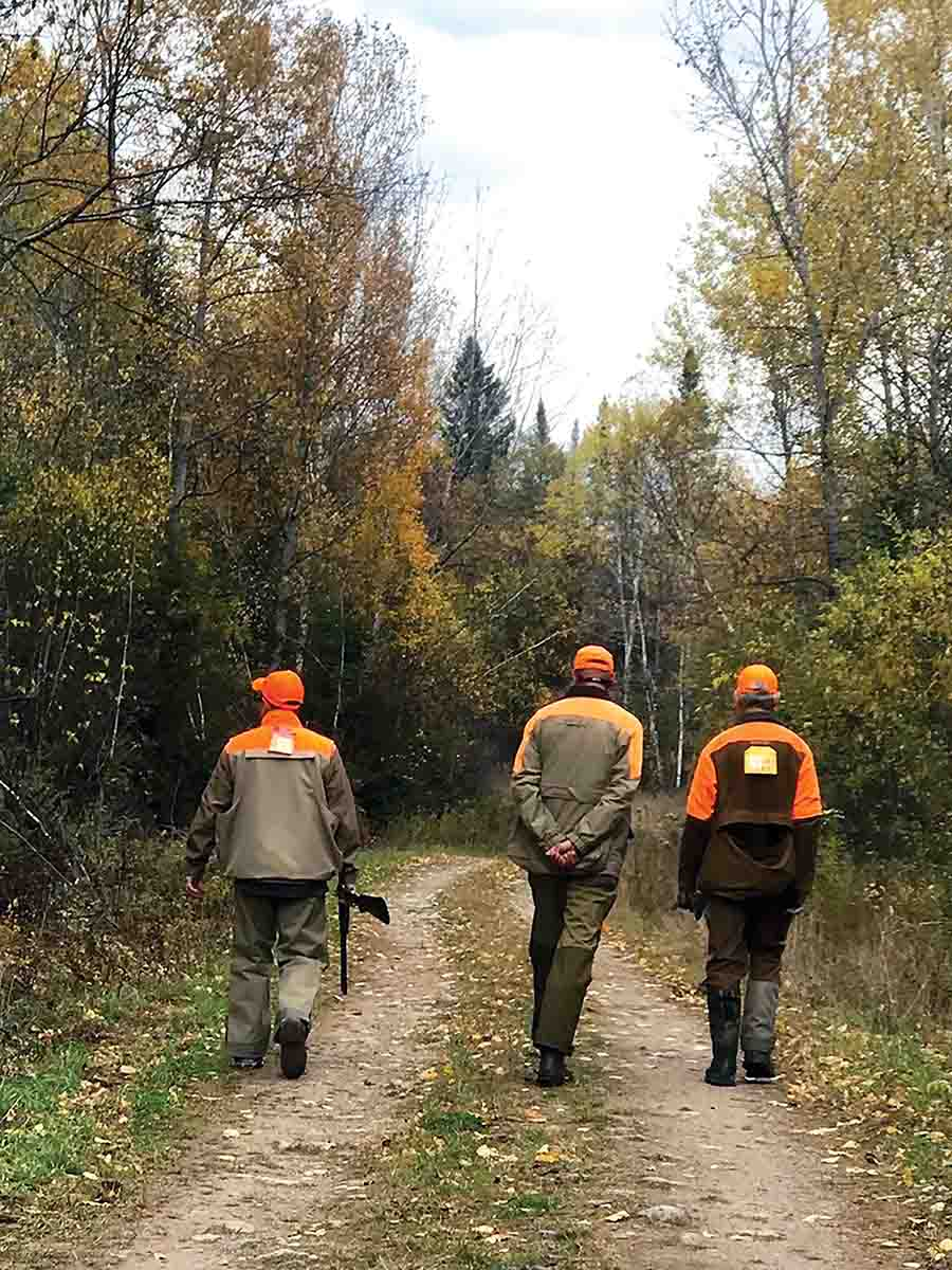 Hunters head back to the truck at day's end with bulging game pouches. (Photo/Matt DeLorenzo)