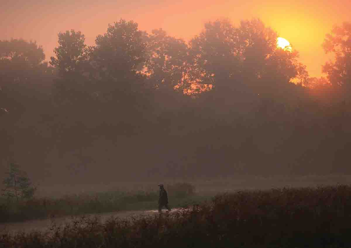 Sunrise on Elbow Slough. This lottery hunter crossed a shallow pond in order to get to higher ground where the doves were flying. (Photo/John K. Flores)