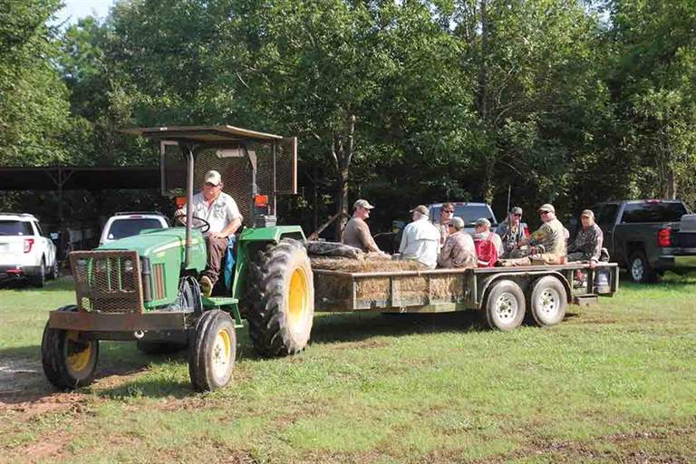 Lottery hunters on Elbow Slough are transported to and from the field by tractor. (Photo/John K. Flores)